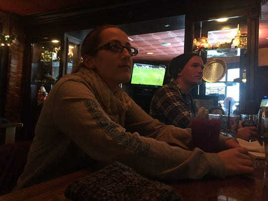 Naomi Katz and boyfriend Alex Kaplan have some drinks at Catherine Rooney's in Wilmington on Saturday, as flurries blanked the region. Cabin fever can be good for businesses during snowstorms.
