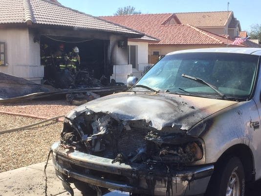 Man injured trying to rescue car from fire