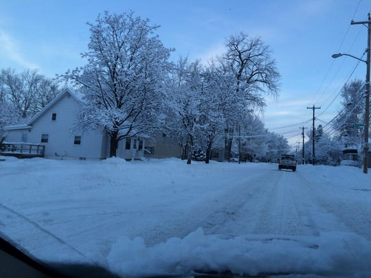Snow covered roads in De Pere Tuesday morning.