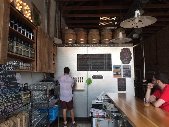 A cozy bar greets visitors to the Pueblo Vida Brewing