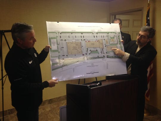 Evesham Mayor Randy Brown (left) and developer Peter Lazaropoulos hold up the plans for an upcoming $30M redevelopment project in Evesham.