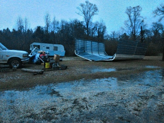 The overturned carport is on Bluff Springs Road.  The trailer with the tree through it is at the corner of Dawson Road and US 29.