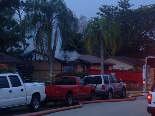 Smoke billows from a Temple Road East home in San Carlos Park after a fire that destroyed the home Sunday rekinlded.