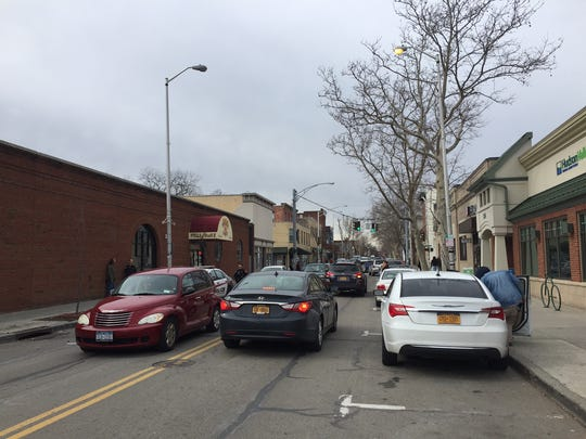 Cars drive on Main Street in the City of Beacon on