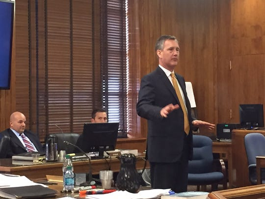 Defense lawyer Marc Dedman speaks to the jury in his