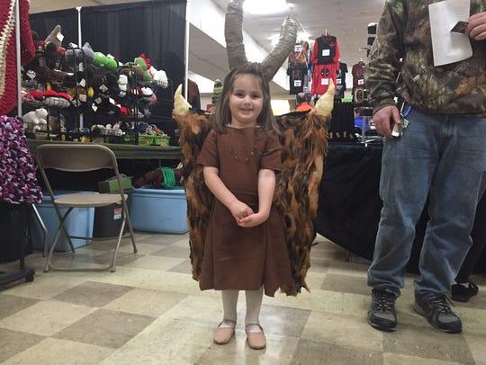 Kensington Wilderson, 4, of York Township, dresses