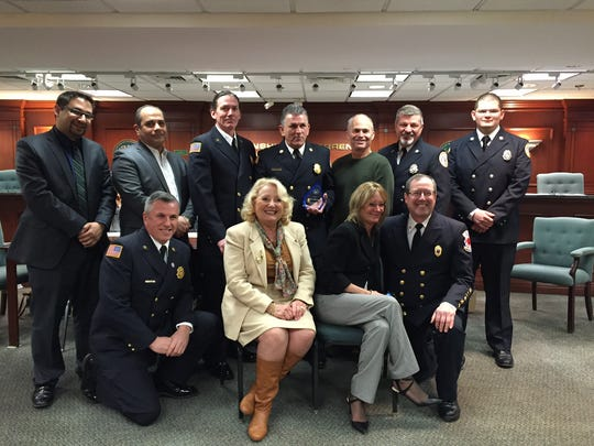 Members of the Warren Twp Fire Dept with Jimmy DeVizio in the middle back row holding his award, Carolann Garafola (1st row 2nd person on left) & Jimmy's wife, Kim, 1st row center, 3rd person.