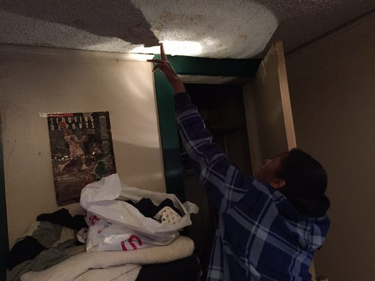 Eula Riser points to a roof leak in a bedroom at her