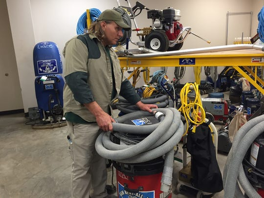 Ram Rent-All owner Shannon Huffty looks over shop-vac