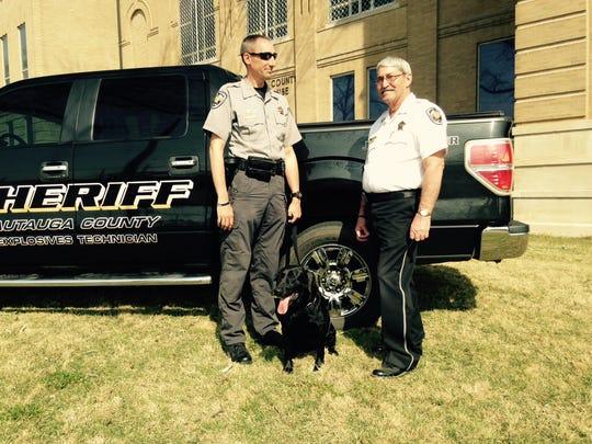 From left, Deputy Matt Higgins, Penny and Sheriff Joe Sedinger.