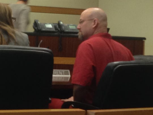 Mark Sievers coponfers with his attorney during a sheltering