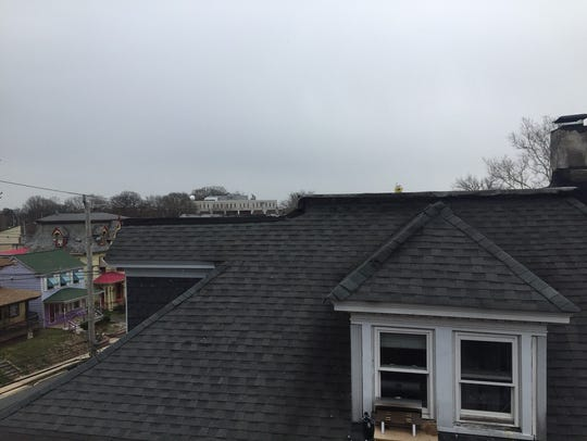 The roof of the home at 153 W. Main St. in Newark is