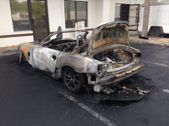 A fire Monday morning destroyed a 2007 BMW awaiting repairs at a Metro Parkway repair shop.