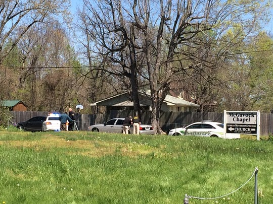 Police on the scene of a death investigation in Charlotte just off Highway 48, Tuesday, April 12, 2016