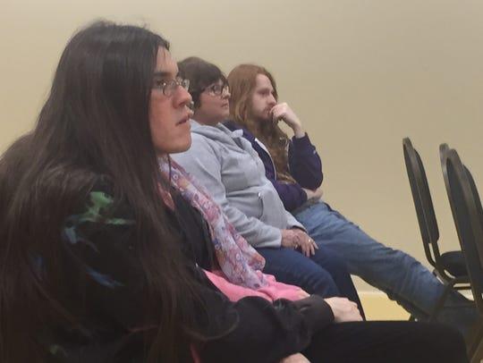 Area Bernie Sanders supporters listen as an area resident