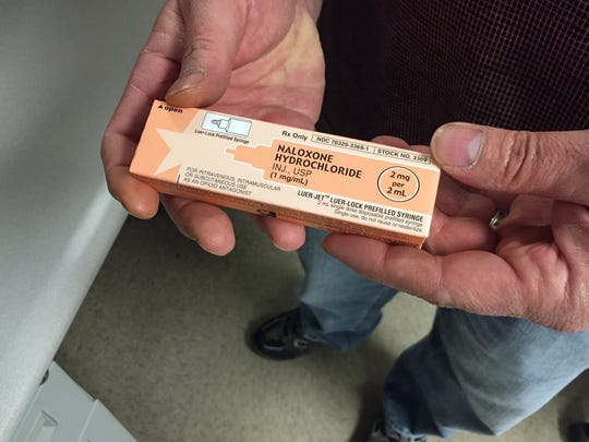 A Bucyrus police officer holds two doses of naloxone, or Narcan, which all county law enforcement officers have on hand at all times to reverse the effects of an opiate drug overdose.