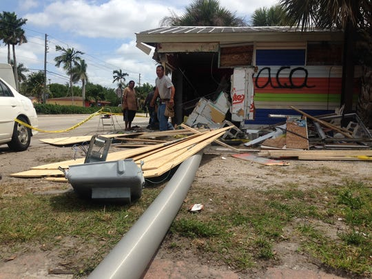 A small  store on Palm Beach Boulevard was severely damaged when a car crashed into it Sunday morning. One person in the car was killed.