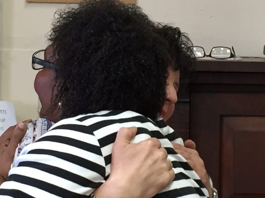 Angela Smith hugs teacher Nancy Hart after a piano