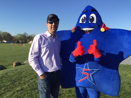 Delaware Stars owner Igor Kouzine and mascot Starball during a visit to Concord Soccer Association fields Wednesday.