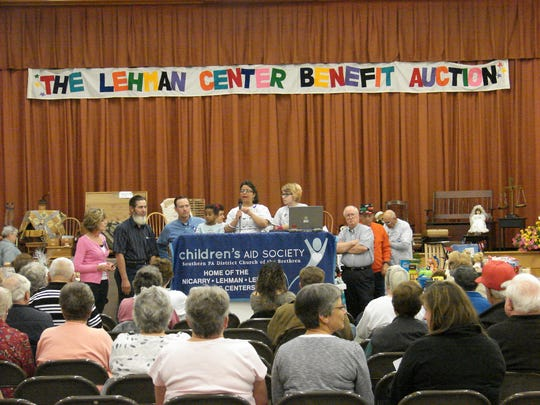 People take part in the 24th Annual Lehman Center Benefit