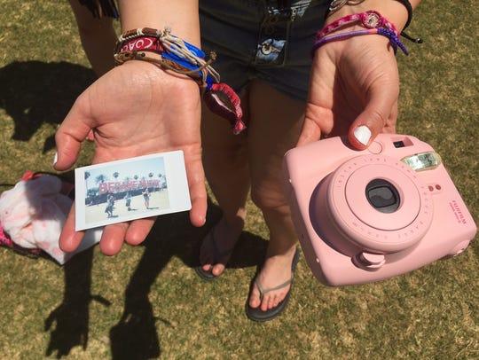 Throwback Polaroid-type camera, photo  at Coachella,