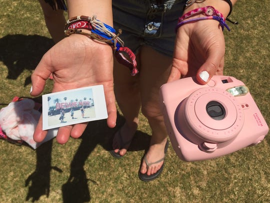 Throwback Polaroid-type camera, photo  at Coachella,