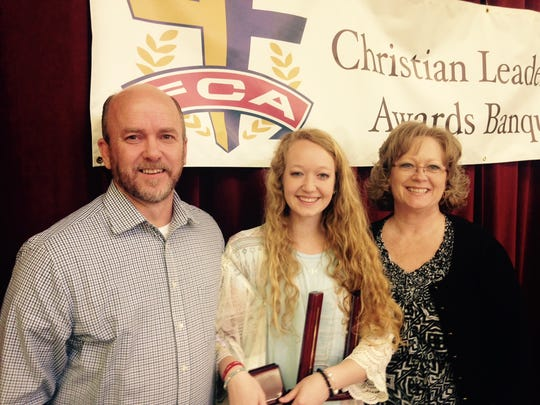 Hannah Lovvorn, center, winner of the Willis Bradford Christian Leadership Award, with her parents Chris and Susanne Lovvorn.