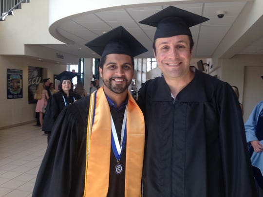 Manuel Sanchez Zayas with his mentor, Dr. Arsalan Mirjafari, at FGCU's 39th commencement on Sunday. Sanchez Zayas will be heading to work on his doctorate in California.