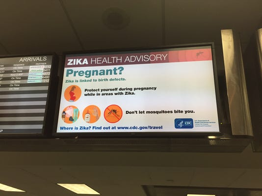 635978833597073487-At-Fort-Lauderdale-Zika-virus-information-is-on-display-screens-right-nex-to-the-flight-information-screens-courtesy-FLL-Airport.JPG