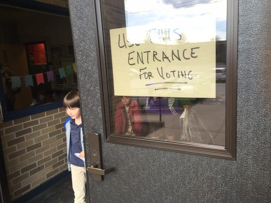 This handwritten sign was the only notice on IPS School 60 telling voters where to come to cast their ballots in Tuesday's Indiana primary election. The school  is at 3300 N Pennsylvania St.