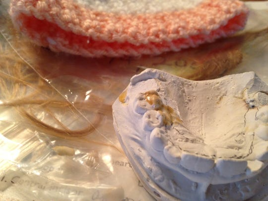 A knitted cap, five teeth, clumps of hair and a dental mold? Keepsakes of a serial killer, right? Sure. Or a mom.
