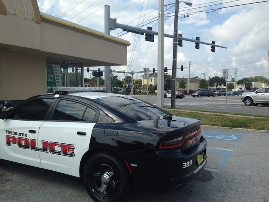 A Melbourne police car is parked outside the Subway sandwich shop at Eau Gallie and U.S. 1.