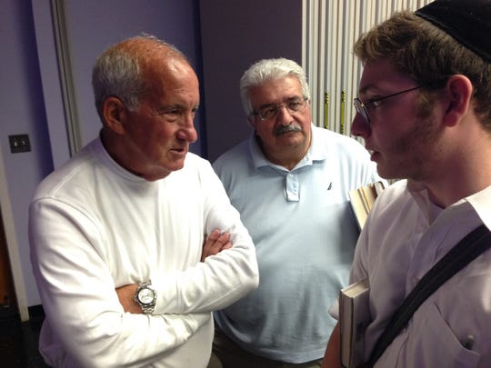 """William Ball (left) of Howell and David Spinrad (right), an Orthodox Lakewood resident,  talk Monday night, May 23, 2016, at a presentation by the author of """"Heart of the Stranger: A Portrait of Lakewood's Orthodox Community."""""""