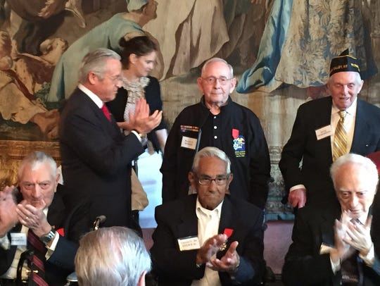 Bob Rohde, standing, center, received the French Legion