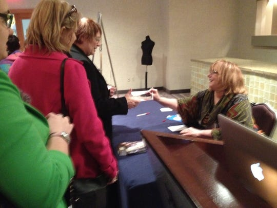 Here's Nicky Epstein signing books after a talk at Vogue Knitting Live.