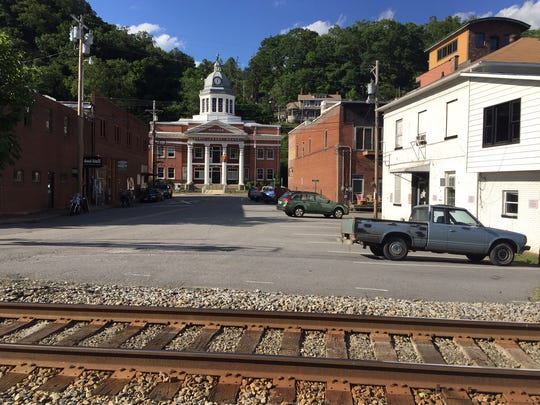 Downtown Marshall is set close by the railroad tracks and the French Broad River. At right is the former Madison County Jail with the courthouse in the background.