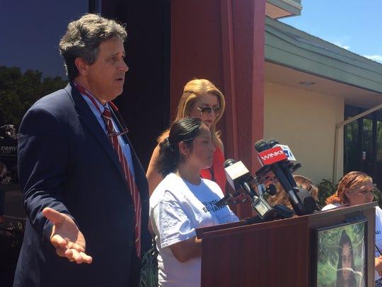 Attorney Thomas R. Bussata stands next to Diamna Alvarez's