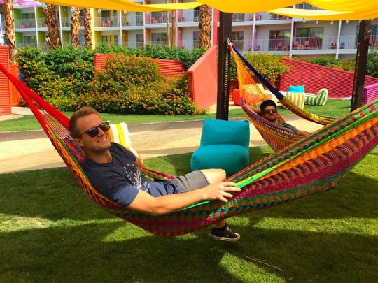 Tyler McLean, foreground, co-creator of Splash House, checks out the hammock village at The Saguaro Palm Springs on June 10, 2016.