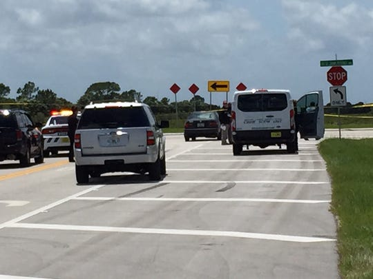 Vehicles remain in the roadway after a shooting involving an off duty-deputy Monday (June 19).