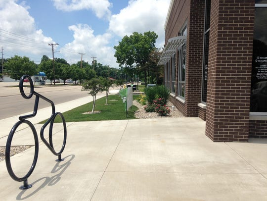 A bike rack stands in front of the new Mutual Bank