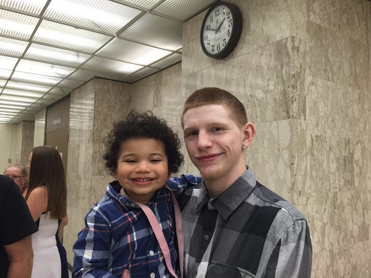 Jordan Javan Robinson, 2, with his uncle Michael Kagan.  Jordan's father, Javan Robinson, was struck and killed in 2014 by a drunken driver, 18 days before Jordan was born.