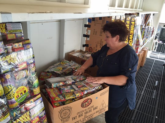 Pam Chesterman, senior pastor at Calvary Christian Center, unloads fireworks at the group's fireworks stand at Vista Chino and Landau in Cathedral City on Monday, June 27, 2016.