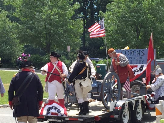 Members of Coren's Independent Artillery re-enactment group blast the cannon to launch the 2016 Randolph Kiwanis Freedom Parade, July 2, 2016.