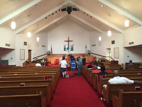 People began arriving early for Friday's morning prayer vigil at Evergreen Baptist Church in Shreveport.