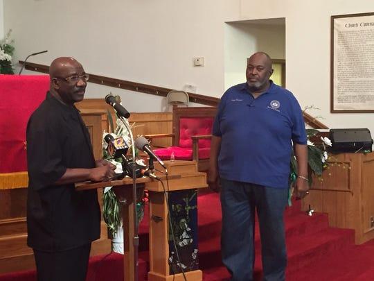 Arthur Douglas, pastor of Evergreen Baptist Church, opens Friday's prayer vigil with Lloyd Thompson, president of the Shreveport chapter of the NAACP.