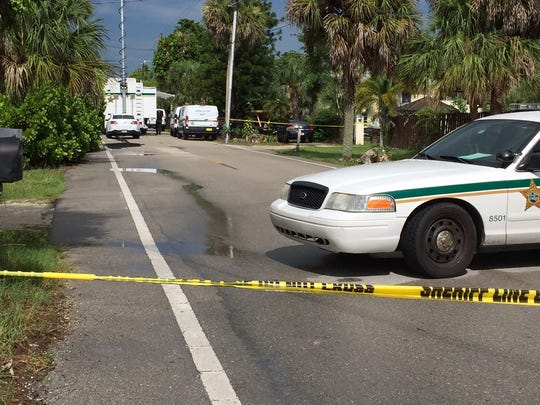 Both ends of Goodwin Street in Bonita Springs are blocked off by police tape as units from the Lee County Sheriff's Office investigate the shooting death of 19-year-old Jordan Valero.