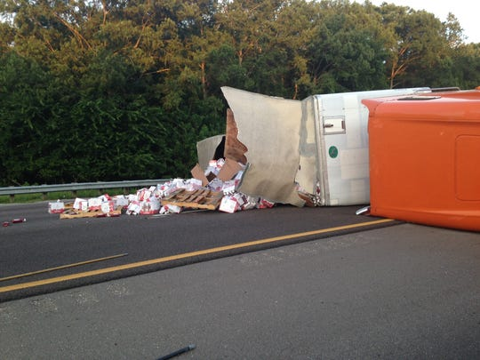 The overturned truck on I-95.