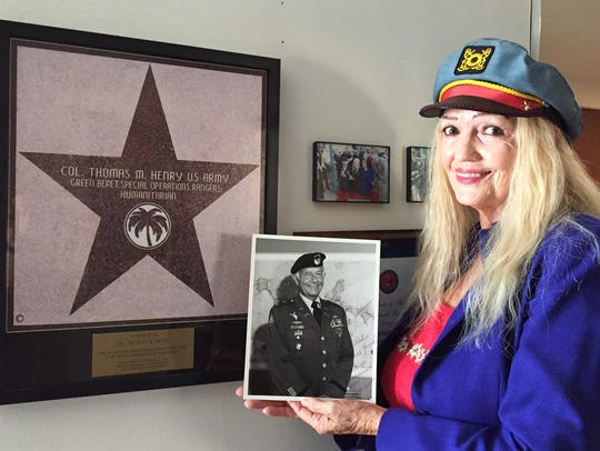 Linda Chapman-Henry, widow of Col. Tom Henry, poses
