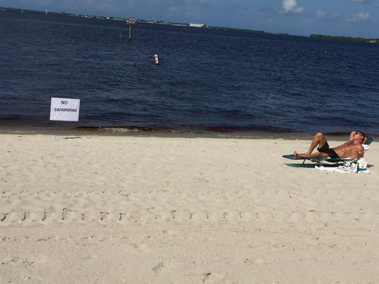 """Dale Rinderle of Cape Coral said he was unaware that the beach at the Cape Coal Yacht Club was closed to swimming Sunday before he got there. I guess they're looking out for our safety,"""" he said."""