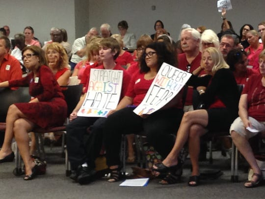 Supporters wear red during a School Board meeting at which members were expected to vote on the contentious LGBT policy.